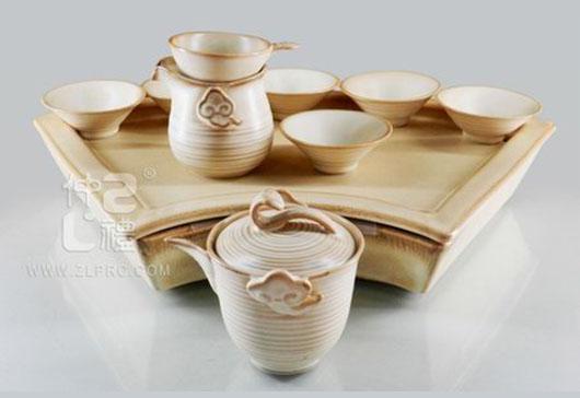浅亚光棕釉扇形盘高如意壶反口杯12头茶具组